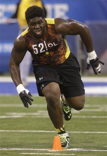 Alabama offensive lineman Chance Warmack runs a drill during the NFL football scouting combine in Indianapolis, Saturday, Feb. 23, 2013. (AP Photo/Dave Martin)
