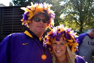 LSU fans Perry and Brooke Shinogle get ready for gameday in Tuscaloosa. (Photo, al.com)