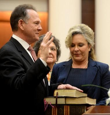 Roy Moore being sworn in. (Julie Bennett / jbennett@al.com)