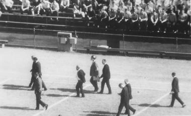 """Bear"" wears a helmet: University of Alabama football coach Paul ""Bear"" Bryant wears a helmet at Grant Field in Atlanta where the Crimson Tide defeated Georgia Tech on Nov. 14, 1964. Whiskey bottles were tossed at him two years earlier."