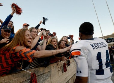 Auburn fans celebrate with quarterback Nick Marshall (14) after the 45-41 victory over Texas A&M at Kyle Field in College Station, Texas. (Julie Bennett/jbennett@al.com)