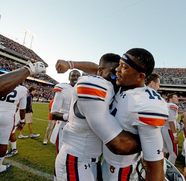 Auburn quarterback Nick Marshall (14) celebrates with teammates after the 45-41 victory over Texas A&M at Kyle Field in College Station, Texas. (Julie Bennett/jbennett@al.com)