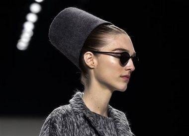 Felt cylinder hats: The Carolina Herrera Fall 2014 collection is modeled during Fashion Week in New York, Monday, Feb. 10, 2014. (AP Photo/Richard Drew)