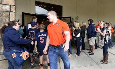 Former Auburn football player Jay Prosch greets fans on A-Day Saturday, April 19, 2014, at Kinnucan's in Auburn, Ala. (Julie Bennett/jbennett@al.com)