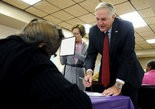 Alabama Attorney General Luther Strange signs in to vote at his polling place at George Washington Middle School in Pike Road, Ala., on Tuesday, Nov. 4, 2014.