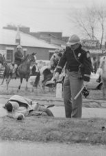 March 7, 1965, Selma: Amelia Boynton Robinson, who was beaten unconscious, lies along the road in Selma. Using batons and tear gas, Alabama state troopers break up the march from Selma to Montgomery at the Edmund Pettus Bridge. The clash became known as 'Bloody Sunday' (Tom Langford\The Birmingham News)