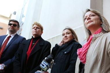 Cari Searcy, second from right, and Kim McKeand speak on Jan. 26, 2015, in Mobile, Ala., about a case that struck down Alabama's same-sex marriage ban. The couple, married in 2005 in California, have been able to file a joint federal tax return but until now not a joint tax return. (Sharon Steinmann/ssteinmann@al.com)