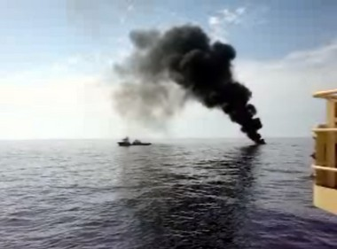 This Coast Guard image shows an intentional burn of spilled oil in the Gulf in late April 2010. Government plans called for the immediate corralling and burning of escaped oil as it surfaced. What the government wasn't saying was that it had no fire booms available, and had to contact an Illinois manufacturer. Meanwhile, millions of gallons of oil were spreading over thousands of square miles of open water. (AP Photo/U.S. Coast Guard)