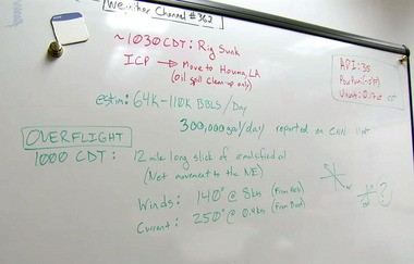 A still image from a video downloaded from the National Oceanic and Atmospheric Administration Web site shows a dry erase board with figures charting the potential oil flow from the ruptured well. (File)