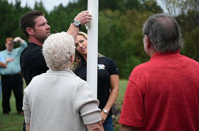Homes for our Troops created a new Shelby County home for veteran Noah Galloway that is accessible for his needs as a double amputee. Galloway raises an American flag for the home. (Tamika Moore/ tmoore@al.com)