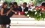 Michael Moore's mother Shunta Daugherty, center, is comforted as she mourns the loss of her son at Whispering Pines Cemetery in Eight Mile, Ala., on Tuesday June 21, 2016. Moore, 19, was shot by a Mobile police officer following a traffic stop on Monday June 13. (Sharon Steinmann/ssteinmann@al.com)