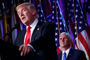 Vice president-elect Mike Pence, right, watches as President-elect Donald Trump speaks during an election night rally, Wednesday, Nov. 9, 2016, in New York. (AP Photo/ Evan Vucci)