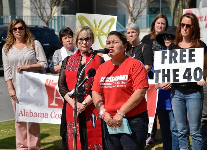"""""""Free the Alabama 40"""" rally on the steps of the Madison County Courthouse in Huntsville, Ala. Tuesday March 21, 2017 organized by the Alabama Coalition for Immigrant Justice. Evelyn Servin, North Alabama regional organizer for the Alabama Coalition for Immigrant Justice speaks at the rally. The group demanded the release of about 40 immigrants that recently were detained by federal agents.See more here. (Bob Gathany / bgathany@AL.com)"""