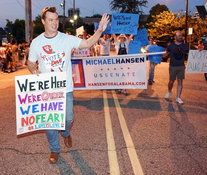 U.S. Senate candidate Michael Hansen walks the parade route. The 39th annual Birmingham Pride Parade rolled through the streets of Birmingham Saturday June 10, 2017.