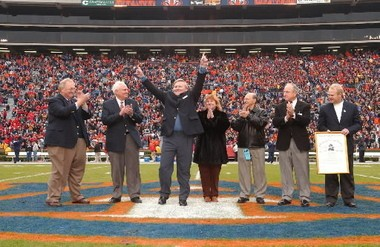 Former Auburn receiver Terry Beasley, hands outstretched, at Jordan-Hare Stadium after being elected to the College Football Hall of Fame. (File photo)