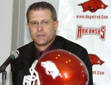 Gus Malzahn answers a question during a news conference called by coach Houston Nutt to announce Malzahn's hire as Arkansas' offensive coordinator at the Broyles Center in Fayetteville, Ark., Friday, Dec. 9, 2005. (AP Photo/April L. Brown)