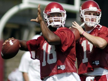Robert Johnson, left, was named Arkansas' starter in preseason camp in 2006. Casey Dick, right, took the starting job from Johnson during the 2005 season, but a back injury in the offseason sidelined Dick for the first half of the 2006 season. Freshman Mitch Mustain (not pictured) became the starting quarterback following a 50-14 loss to Southern Cal in Week 1, and held on to the starting job until a late-season game at South Carolina, where Dick would take over following an interception on Mustain's first throw of the game. (AP Photo/April L. Brown)
