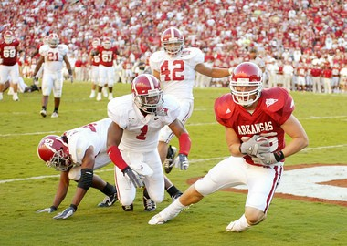 Arkansas' Ben Cleveland clutches a touchdown pass from Mitch Mustain during the second overtime of the Razorbacks' 24-23 victory over Alabama on Sept. 23, 2006 at Reynolds Razorback Stadium in Fayetteville, Ark. The touchdown tied the game, and Arkansas won when Jeremy Davis kicked the extra point. (Mobile Press-Register file photo)