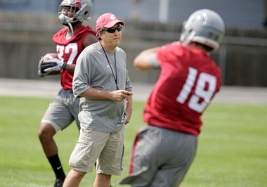 Washington State head coach Mike Leach, center, watches wide receivers Brett Bartolone, right, and Bobby Ratliff, left, run drills during the fall camp opening practice Friday, Aug. 2, 2013, at Sacajawea Junior High School in Lewiston. (AP Photo/Moscow-Pullman Daily News, Dean Hare)