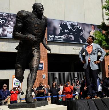 Auburn's Cam Newton takes a look at his statue Saturday on Auburn A-Day on Saturday, April 14, 2012 in Auburn, Ala. (Todd Van Emst/Auburn Media Relations)
