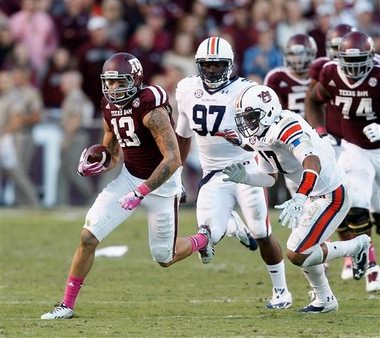 Auburn linebacker Kris Frost (17) tries to chase down a running Mike Evans (13) in Auburn's 45-41 victory over Texas A&M Saturday. (Associated Press)