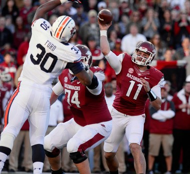 Auburn's Dee Ford tips a pass from Arkansas quarterback AJ Derby in the first half to create an interception in the first quarter Saturday, Nov. 2, 2013 in Fayetteville, Arkansas. (Todd Van Emst/Auburn Media Relations)