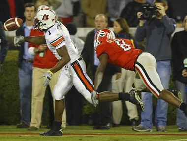Auburn's Devin Aromashodu fumbles the football near the goalline after makig a 4th-and-11 catch against Georgia late in the fourth quarter, Saturday, Nov. 12, 2005 in Athens, Ga. Defending is Georgia's Paul Oliver. (G.M. Andrews/File photo)
