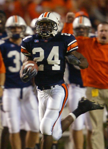Auburn running back Carnell Williams runs for an 80-yard touchdown on the first play from scrimmage against Alabama Saturday Nov. 22, 2003 at Jordan-Hare Stadium in Auburn, Ala. (File photo)