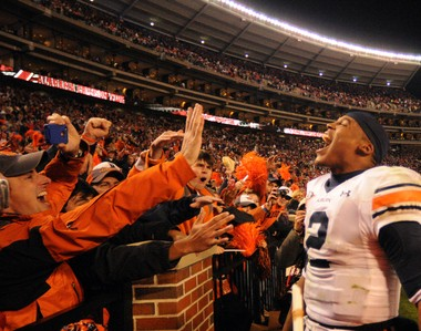 Auburn quarterback Cam Newton celebrates after a 28-27 victory at Bryant-Denny Stadium on November 26, 2010 in Tuscaloosa, Ala. (File photo)