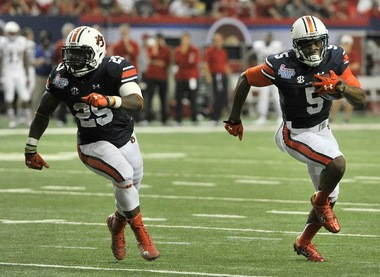 Auburn wide receiver Ricardo Louis (5) runs for a touchdown as running back Peyton Barber (25) prepares to clear a path to the end zone during the second half of the Chick-fil-A Kickoff Game Saturday, Sept. 5, 2015, at the Georgia Dome in Atlanta, Ga. (Julie Bennett/jbennett@al.com)