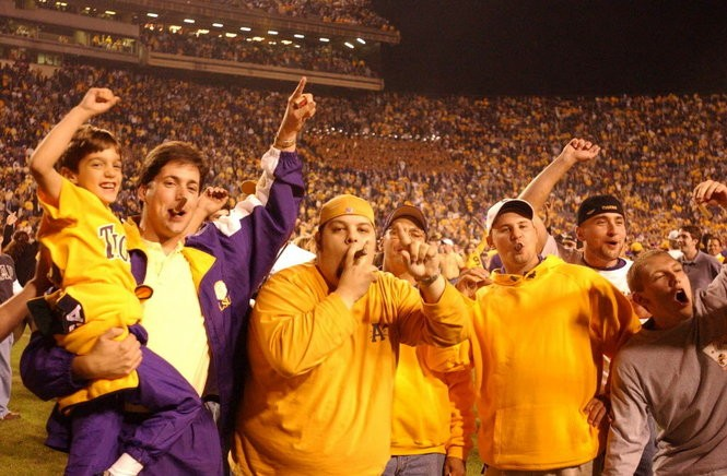 LSU fans smoke cigars on the field following a victory against Auburn in 2001.(File/Philip Barr)