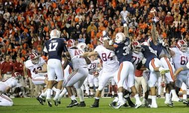 Auburn defensive end Nosa Eguae blocks a field goal attempt by Alabama kicker Cade Foster Saturday, Nov. 30, 2013, during the fourth quarter of the Iron Bowl at Jordan-Hare Stadium in Auburn, Ala. (Julie Bennett/jbennett@al.com)