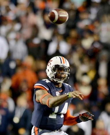 Auburn quarterback Nick Marshall (14) passes to Auburn wide receiver Sammie Coates (18) for a touchdown Saturday, Nov. 30, 2013, during the fourth quarter of the Iron Bowl at Jordan-Hare Stadium in Auburn, Ala. (Julie Bennett/jbennett@al.com)