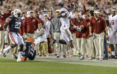 Alabama running back T.J. Yeldon (4) goes out of bounds with one second to play in the 2013 Iron Bowl on Saturday, Nov. 30, 2013, at Jordan-Hare Stadium in Auburn, Ala. (Vasha Hunt/vhunt@al.com)
