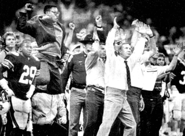 Auburn head coach Pat Dye throws his arms up after Win Lyle makes a field goal to end the 1988 Sugar Bowl with a tie. (New Orleans Times-Picayune)
