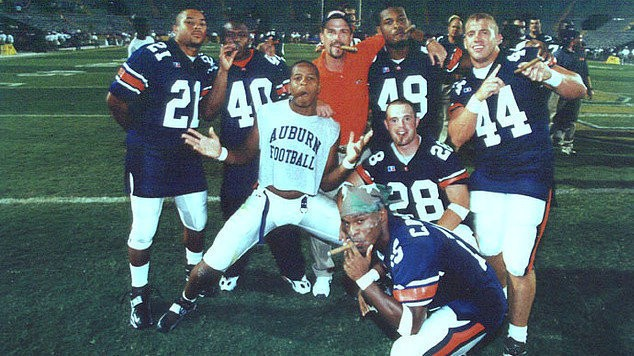 Auburn players hold their cigars and pose for a photo following a 41-7 victory against LSU inside Tiger Stadium in Baton Rouge, La., in 1999. (AuburnTigers.com)