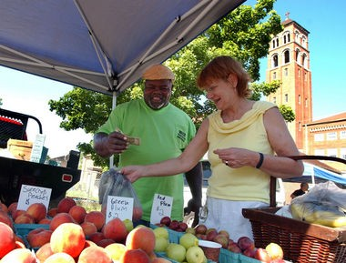 Volunteers deliver fresh produce from local farmers to some 150 seniors through East Lake United Methodist Church's P.E.E.R. program. The East Lake Farmers Market is open every Saturday through Oct. 10. (File photo)