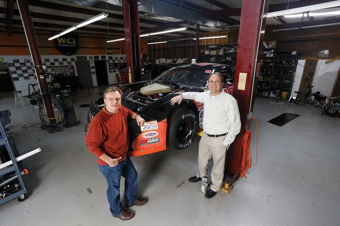 Brothers Bobby (left) and Roger (right) in the Alabaster facility that houses their race cars.