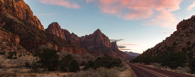 Sunset at Zion National Park is especially scenic due to the red rocks for which it's known.