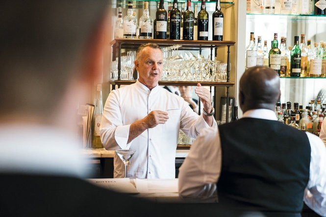 Chef Frank Stitt discusses dinner service with Bottega's staff. Photo by Cary Norton.