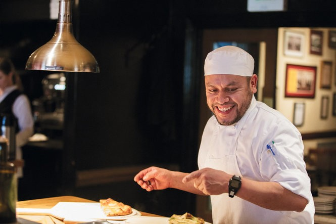 Paco LaTorre works in the kitchen. Photo by Cary Norton.