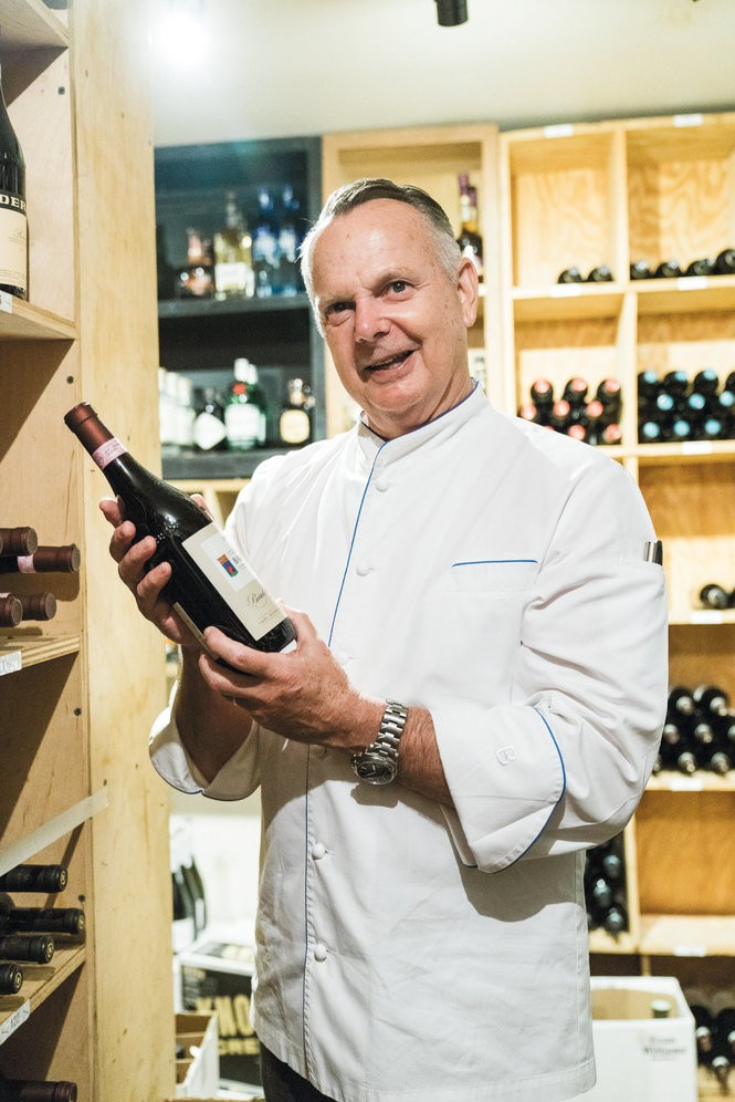 Chef Stitt shows off a bottle of wine from the restaurant's collection. Photo by Cary Norton.