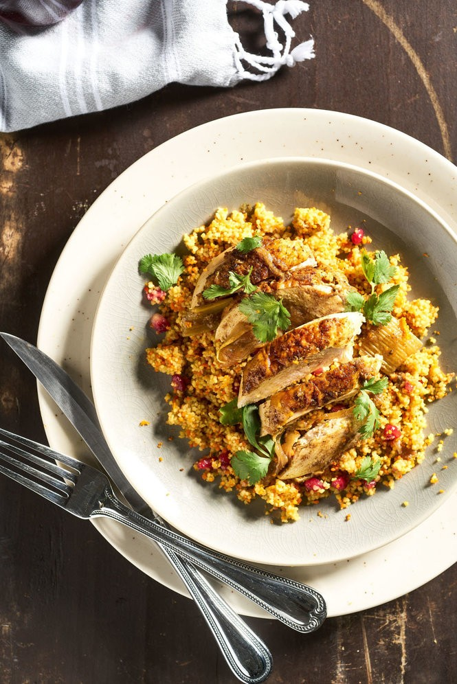 Roasted Chicken with Pomegranate Au Jus and Pomegranate Curry Couscous. Photo by Jacob Blount.