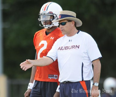 Then-offensive coordinator Gus Malzahn teaches Cam Newton during training camp practices in 2010. (Hal Yeager/Birmingham News)