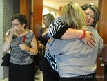 A Jefferson County jury awarded more than $40 million in damages to the family of a church music minister in a drunken driving wreck. Shown here in 2012, family members Paulette Rush, (left), mother of Derric Rush, and Peggy Rush, (in gray shirt) widow of Derric Rush, is hugged by Tonya Gibson, (in black and white shirt) after the sentencing of James Kendrick in his criminal case. (The Birmingham News file)