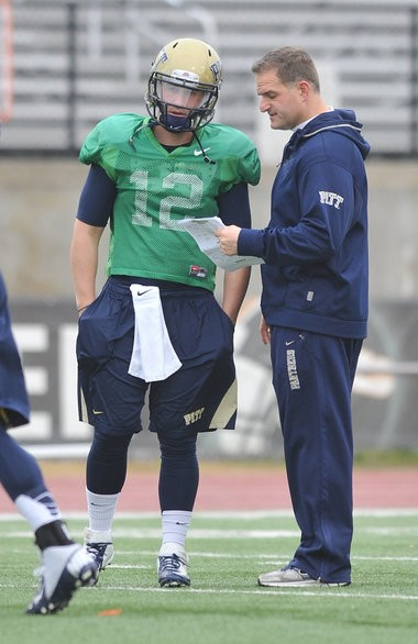 Pittsburgh quarterback Tino Sunseri (12) talks with Offensive Coordinator Joe Rudolph during practice. Pitt practiced Wednesday January 2, 2012 at Hoover High School and will Ole Miss in the BBVA Compass Bowl January 5 at Legion Field in Birmingham, Alabama.