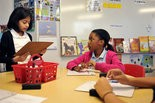 Fourth grade students at Epic School work on an activity with Birmingham City Schools gifted specialist Audrey Fine. (Tamika Moore   tmoore@al.com)