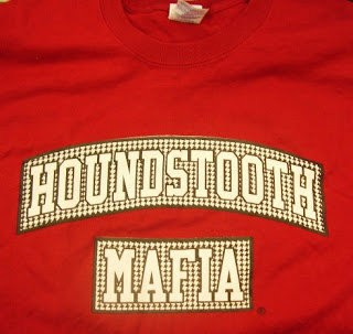 A Houndstooth Mafia shirt is shown. The University of Alabama lost a federal trademark appeals court case involving this logo by two Alabama fans who want to sell clothing with that logo. But the University has filed a federal lawsuit against Houndstooth Mafia as an appeal to block it. The case is still pending.