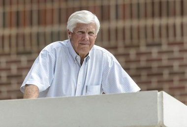 Alabama athletics director Bill Battle watches over football practice from outside his office Monday, Aug. 5, 2013, at the Thomas-Drew Practice Facility in Tuscaloosa, Ala. (Vasha Hunt/vhunt@al.com)