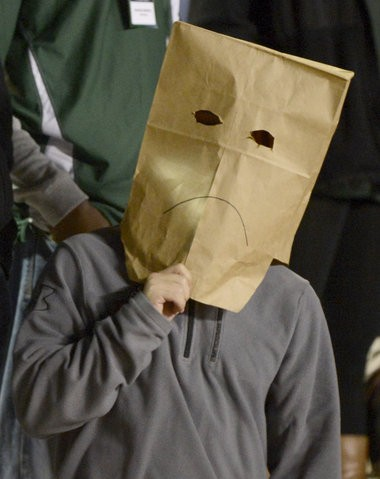 An unknown fan is shown with a bag over his head at Legion Field for last Thursday's UAB-Rice game. (Mark Almond/malmond@al.com)